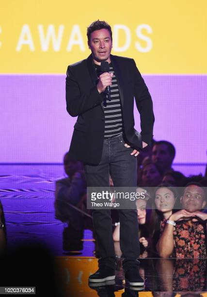 Jimmy Fallon speaks onstage during the 2018 MTV Video Music Awards at Radio City Music Hall on August 20 2018 in New York City