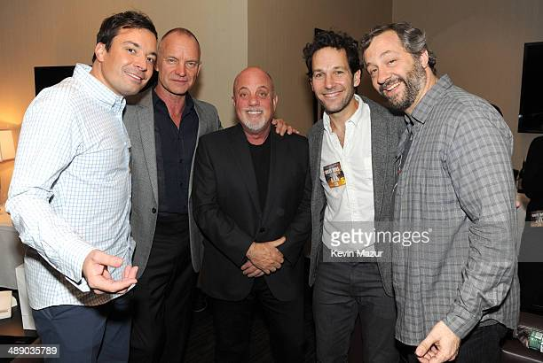 Jimmy Fallon Sting Billy Joel Paul Rudd and Judd Apatow backstage at Madison Square Garden on May 9 2014 in New York City