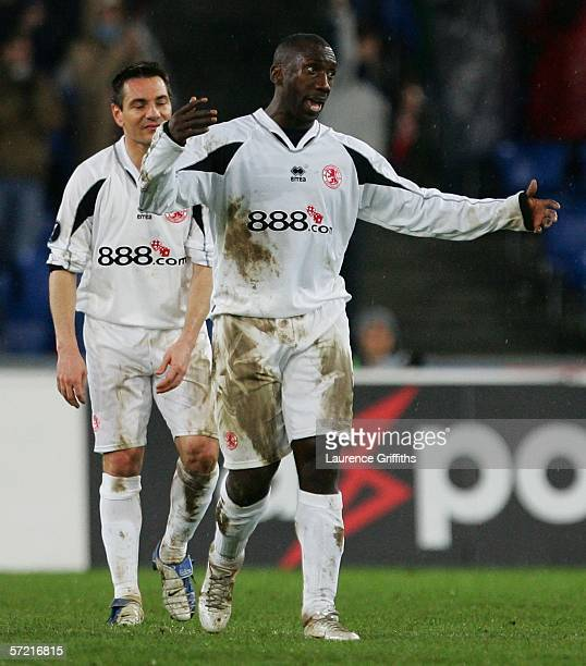 Jimmy Floyd Hasselbaink and Doriva of Middlesbrough show their frustrations after FC Basel score the second goal during the UEFA Cup Quarter Final...