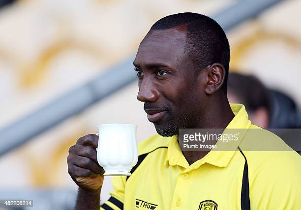 Jimmy Floyd Hasselbaink of Burton Albion enjoys a cup of tea ahead of the pre-season friendly between Burton Albion and Leicester City at Pirelli...