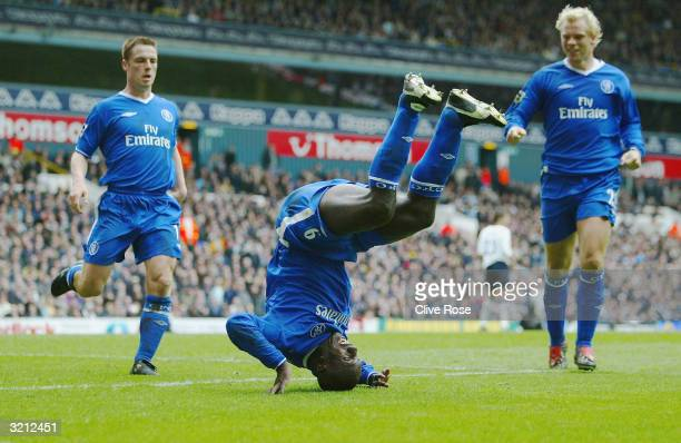 Jimmy Floyd Hasselbaink of Chelsea celebrates scoring the first goal against Tottenham Hotspur and is joined by team mates Scott Parker and Eidur...