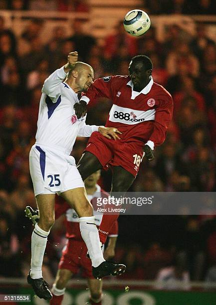 Jimmy Floyd Hasselbaink of Middlesbrough beats Jan Velkoborsky of Banik Ostrava to a header during the UEFA Cup first round, first leg match between...