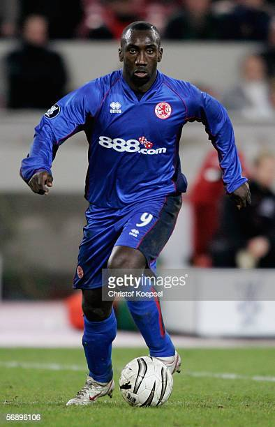 Jimmy Floyd Hasselbaink of Middlesbrough runs with the ball during the UEFA Cup Round of 32 match between VFB Stuttgart and FC Middlesbrough at the...