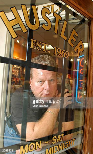 Jimmy Flynt, owner of Hustler Cincinnati, looks out the front door of his store June 19, 2003 in Cincinnati, Ohio. The Hamilton County Sheriff's...