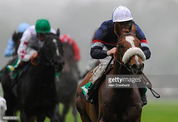 Jimmy Fortune riding Tullius win The bet365 Mile at Sandown racecourse on April 25 2014 in Esher England