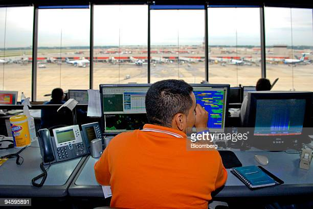 Jimmy Gallo an operations specialist monitors AirTran flights from the concourse D control tower at HartsfieldJackson International Airport in...