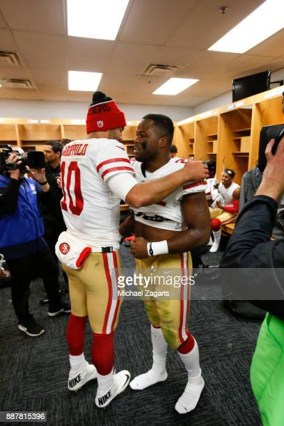Jimmy Garoppolo and Carlos Hyde of the San Francisco 49ers celebrate in the locker room following the game against the Chicago Bears at Soldier Field...