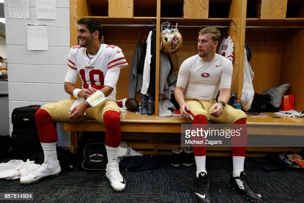 Jimmy Garoppolo and CJ Beathard of the San Francisco 49ers sit in the locker room prior to the game against the Chicago Bears at Soldier Field on...