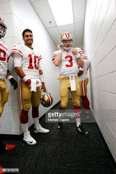 Jimmy Garoppolo and CJ Beathard of the San Francisco 49ers stand in the hallway prior to the game against the Chicago Bears at Soldier Field on...