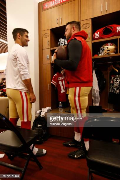 Jimmy Garoppolo and Joe Staley of the San Francisco 49ers talk in the locker room prior to the game against the Tennessee Titans at Levi's Stadium on...