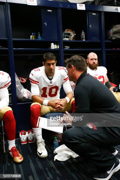 Jimmy Garoppolo and Quarterbacks Coach Rich Scangarello of the San Francisco 49ers talk in the locker room prior to the game against the Houston...
