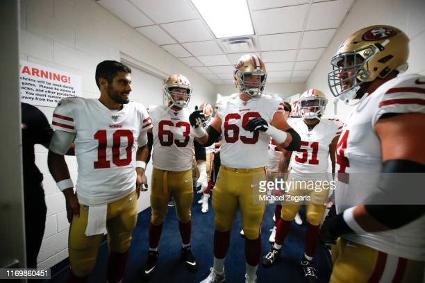 Jimmy Garoppolo Ben Garland Mike McGlinchey and Joe Staley of the San Francisco 49ers stand in the locker room prior to the game against the Denver...