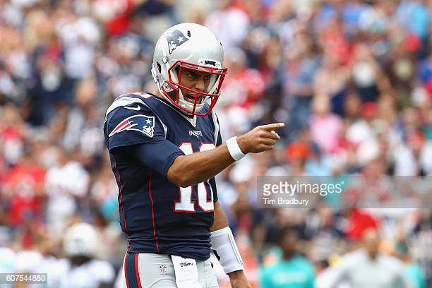 Jimmy Garoppolo of the New England Patriots reacts during the first quarter against the Miami Dolphins at Gillette Stadium on September 18, 2016 in...