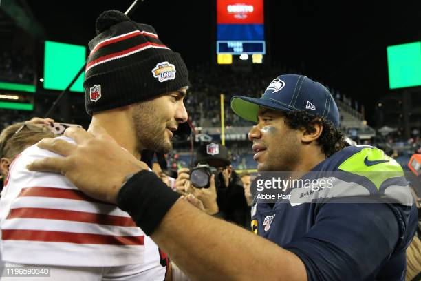Jimmy Garoppolo of the San Francisco 49ers and Russell Wilson of the Seattle Seahawks hug after the San Francisco 49ers defeated the Seattle Seahawks...