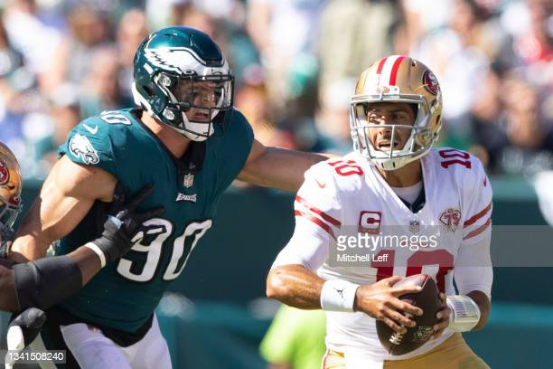 Jimmy Garoppolo of the San Francisco 49ers avoids the pressure from Ryan Kerrigan of the Philadelphia Eagles at Lincoln Financial Field on September...