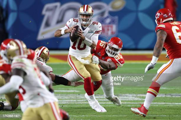 Jimmy Garoppolo of the San Francisco 49ers breaks a tackle from Chris Jones of the Kansas City Chiefs during the second quarter in Super Bowl LIV at...