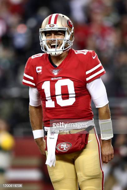 Jimmy Garoppolo of the San Francisco 49ers celebrates a touchdown by Raheem Mostert in the second quarter against the Green Bay Packers during the...