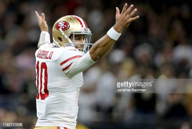 Jimmy Garoppolo of the San Francisco 49ers celebrates a touchdown against the New Orleans Saints during the second quarter in the game at Mercedes...