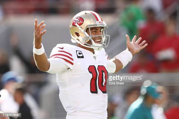 Jimmy Garoppolo of the San Francisco 49ers celebrates after a touchdown against the Carolina Panthers during the second quarter at Levi's Stadium on...