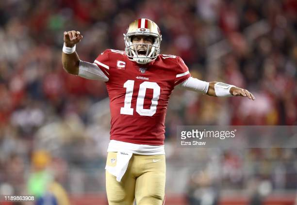 Jimmy Garoppolo of the San Francisco 49ers celebrates after Raheem Mostert ran in for a touchdown in the fourth quarter against the Green Bay Packers...