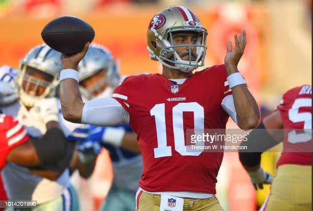 Jimmy Garoppolo of the San Francisco 49ers drops back to pass against the Dallas Cowboys in the first quarter of their NFL preseason football game at...