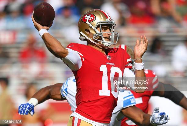 Jimmy Garoppolo of the San Francisco 49ers drops back to pass against the Detroit Lions during the fourth quarter of an NFL football game at Levi's...