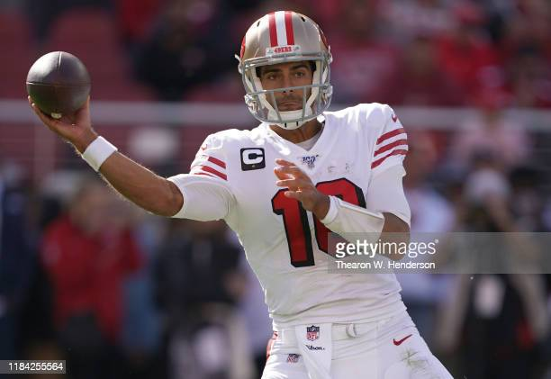 Jimmy Garoppolo of the San Francisco 49ers drops back to pass against the Carolina Panthers during the second quarter of an NFL football game at...