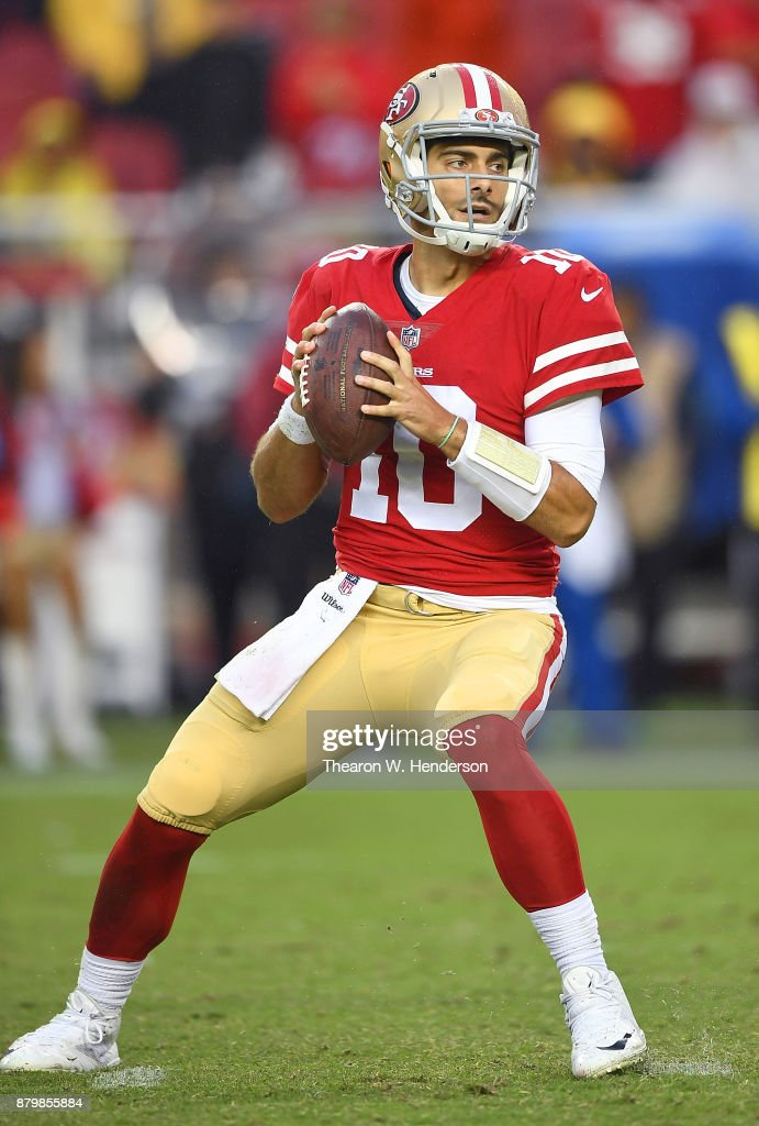 Jimmy Garoppolo #10 of the San Francisco 49ers drops back to pass against the Seattle Seahawks late in their NFL football game at Levi's Stadium on November 26, 2017 in Santa Clara, California. The Seahawks won the game 24-13.
