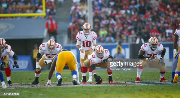 Jimmy Garoppolo of the San Francisco 49ers goes through the snap count during the game against the Los Angeles Rams at Los Angeles Memorial Coliseum...