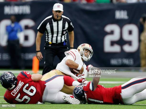 Jimmy Garoppolo of the San Francisco 49ers is sacked by Brian Cushing of the Houston Texans and Zach Cunningham in the second half at NRG Stadium on...