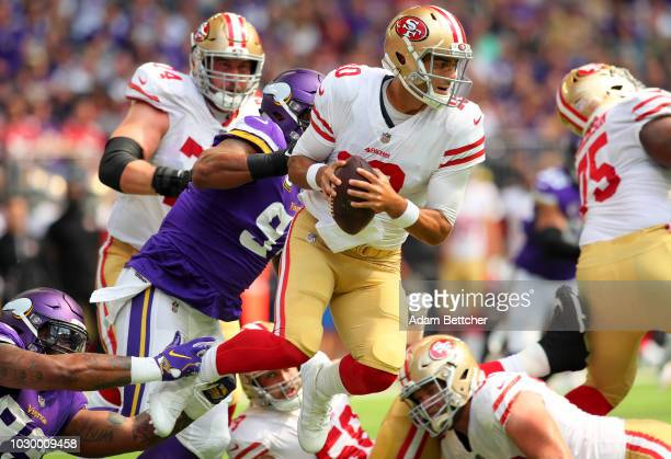 Jimmy Garoppolo of the San Francisco 49ers is sacked by Everson Griffen of the Minnesota Vikings in the first quarter of the game at US Bank Stadium...