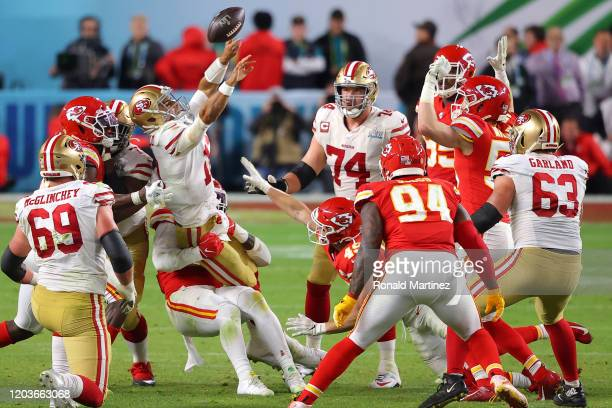 Jimmy Garoppolo of the San Francisco 49ers is sacked by Frank Clark of the Kansas City Chiefs during the fourth quarter in Super Bowl LIV at Hard...