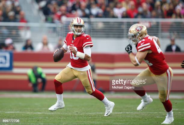 Jimmy Garoppolo of the San Francisco 49ers looks for an open receiver during the game against the Jacksonville Jaguars at Levi's Stadium on December...