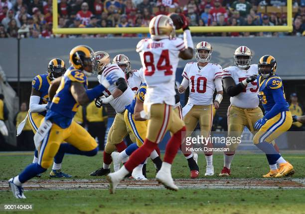 Jimmy Garoppolo of the San Francisco 49ers looks on after completing a pass to Kendrick Bourne during the third quarter against Los Angeles Rams...