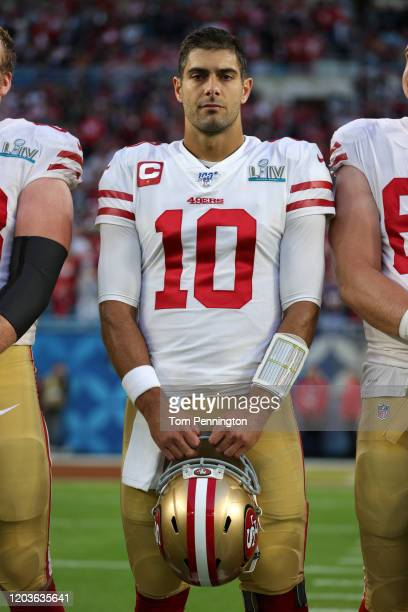 Jimmy Garoppolo of the San Francisco 49ers looks on before Super Bowl LIV against the Kansas City Chiefs at Hard Rock Stadium on February 02 2020 in...