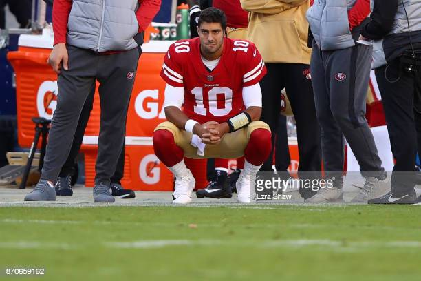 Jimmy Garoppolo of the San Francisco 49ers looks on from the sidelines against the Arizona Cardinals during their NFL game at Levi's Stadium on...