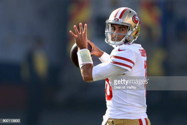Jimmy Garoppolo of the San Francisco 49ers looks to pass during the first half of a game against the Los Angeles Rams at Los Angeles Memorial...