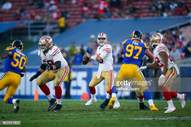 Jimmy Garoppolo of the San Francisco 49ers looks to pass during the game against the Los Angeles Rams at Los Angeles Memorial Coliseum on December 31...