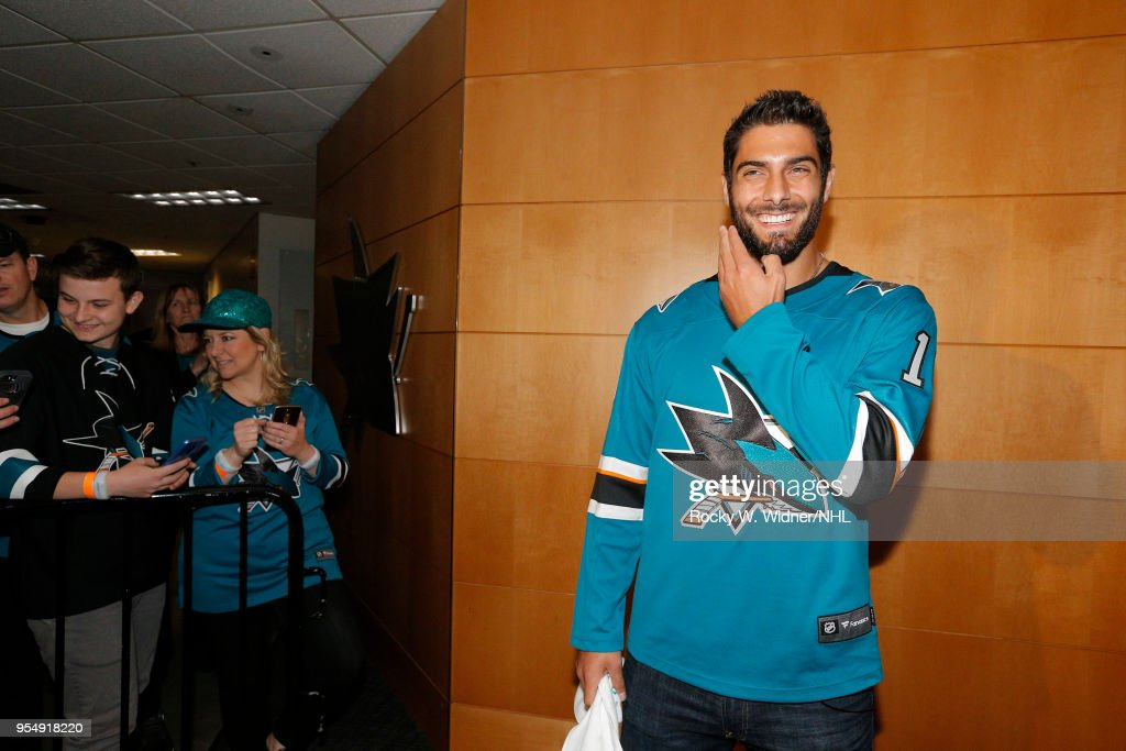 Jimmy Garoppolo of the San Francisco 49ers prepares to greet the San Jose Sharks prior to the game against the Vegas Golden Knights in Game Three of the Western Conference Second Round during the 2018 NHL Stanley Cup Playoffs at SAP Center on April 30, 2018 in San Jose, California. (Photo by Rocky W. Widner/NHL/Getty Images) Jimmy Garoppolo