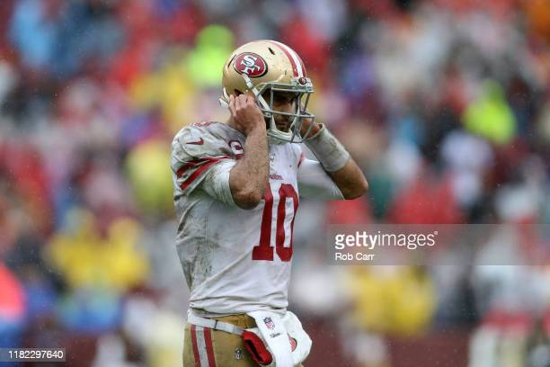 Jimmy Garoppolo of the San Francisco 49ers reacts after a play against the Washington Redskins during the first half in the game at FedExField on...