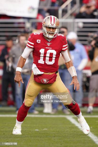 Jimmy Garoppolo of the San Francisco 49ers reacts after a touchdown against the Minnesota Vikings in the third quarter of the NFC Divisional Round...