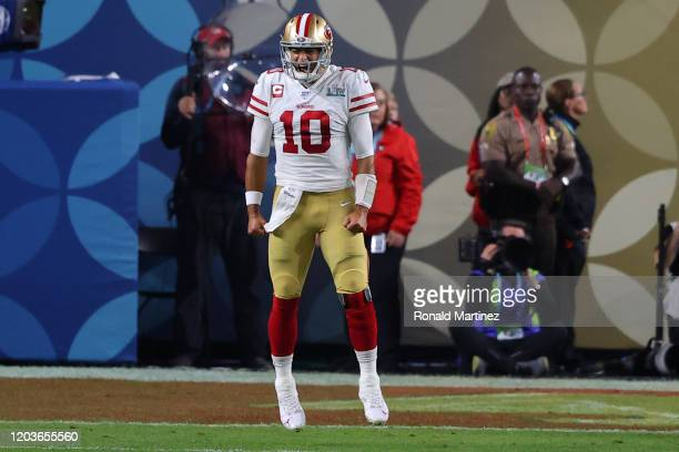 Jimmy Garoppolo of the San Francisco 49ers reacts after a touchdown against the Kansas City Chiefs during the third quarter in Super Bowl LIV at Hard...