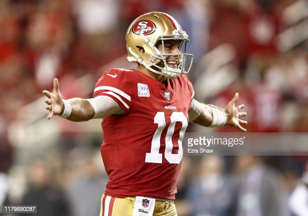 Jimmy Garoppolo of the San Francisco 49ers reacts after he threw a touchdown pass to George Kittle against the Cleveland Browns at Levi's Stadium on...