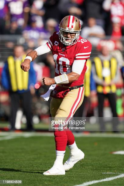 Jimmy Garoppolo of the San Francisco 49ers reacts to throwing a touchdown pass in the first quarter during the NFC Divisional Round Playoff game...