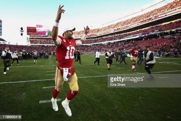 Jimmy Garoppolo of the San Francisco 49ers reacts to winning the NFC Divisional Round Playoff game against the Minnesota Vikings at Levi's Stadium on...