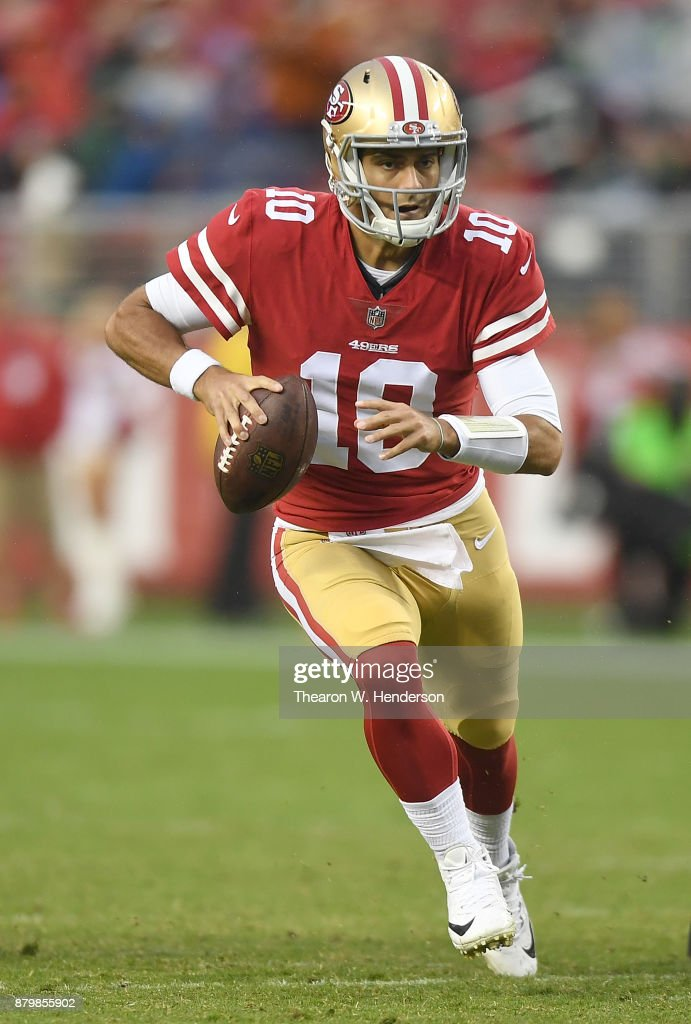 Jimmy Garoppolo #10 of the San Francisco 49ers scrambles with the ball against the Seattle Seahawks late in their NFL football game at Levi's Stadium on November 26, 2017 in Santa Clara, California. The Seahawks won the game 24-13.