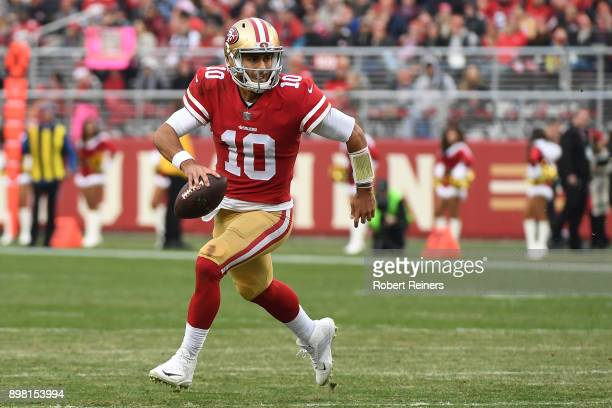 Jimmy Garoppolo of the San Francisco 49ers scrambles with the ball during their NFL game against the Jacksonville Jaguars at Levi's Stadium on...