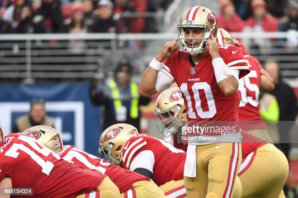 Jimmy Garoppolo of the San Francisco 49ers signalsto his team during their NFL game against the Jacksonville Jaguars at Levi's Stadium on December 24...