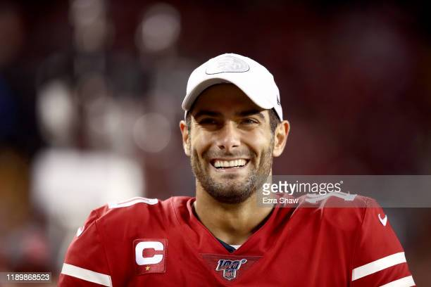 Jimmy Garoppolo of the San Francisco 49ers smiles on the bench during their game against the Green Bay Packers at Levi's Stadium on November 24 2019...