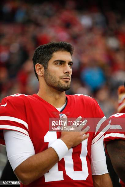 Jimmy Garoppolo of the San Francisco 49ers stands on the sideline during the anthem prior to the game against the Jacksonville Jaguars at Levi's...